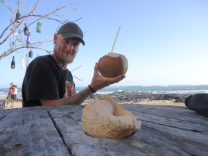 having a coconut drink at Isabela, Galapagos